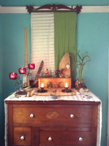 My altar at home where I light candles every morning.