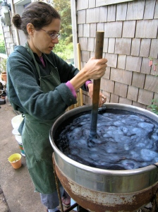 Stirring my young fermentation Indigo Vat in 2005- it was not yet ready to use.