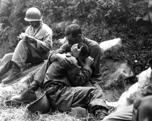 One soldier comforts another who is grief stricken over the death of a buddy killed in action during the Korean War.