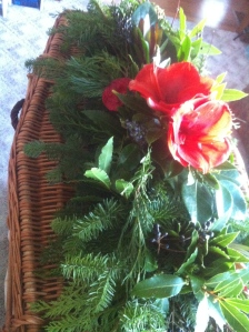 willow casket with locally grown flowers.