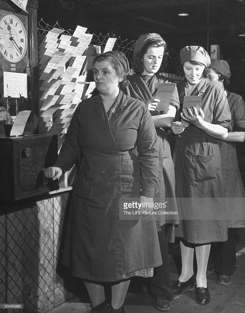 Women waiting in line to have their time cards punched 1942