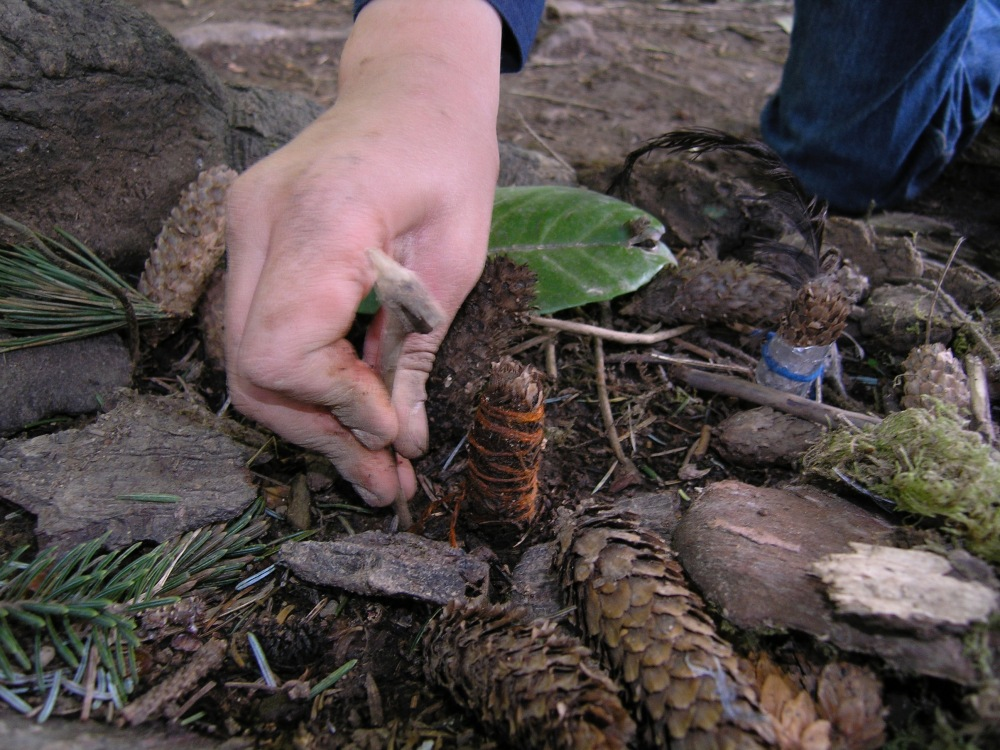 Sam making adjustment to pinecone village around 2007