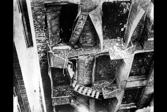 The twisted remains of the lone fire escape.