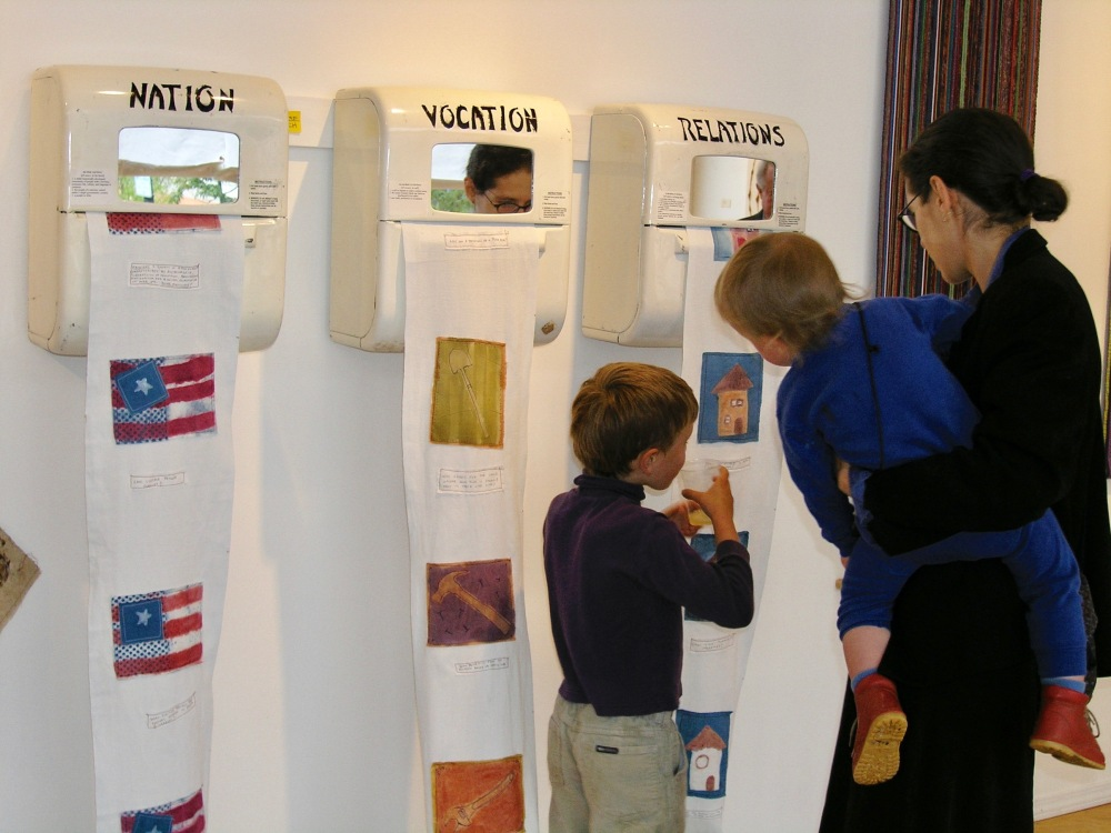 Checking out my installation with the boys June 2004. Each pull of the towel brought a new picture with a question. Print, stencil and paint on 100% cotton. All natural dyes and pigments.